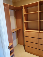 DR Henderson Sonova Beech walk in wardrobe with lots of drawers and shelving
