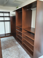 Colour Polytec Jamaican Walnut walk in wardrobe, slide out shoe shelves and lots of hanging space