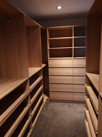 Colour Polytec Natural Oak walk in wardrobe with full backing. Slide out shoe shelves, drawers and hanging