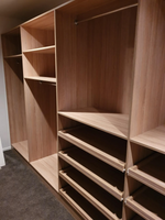 Full colour with full backing walk in wardrobe using Polytec Natural oak