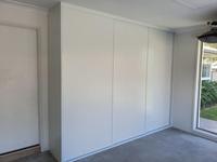 Framed Polytec 'Classic White Ashgrain' sliding doors with Dias Slimline triple track used in garage