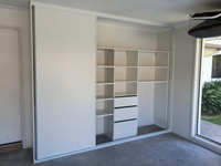 Garage storage behind 3 sliding doors on triple track for ease of access