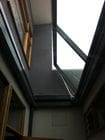 Fitzroy North - Openable glass floor in a balcony (Shown half open). When open converts into balustrading.