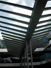 Notting Hill - View from underneath a glass roof covering an outdoor area.