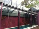 Clifton Hill - An exterior view of the open bi-parting saw tooth style retractable roof over a pool