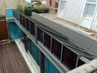Clifton Hill - Another exterior view of the closed bi-parting saw tooth style retractable roof over a pool