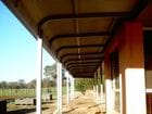 Longwood - A view standing under the bullnose style verandah