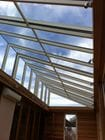 Werribee - An internal view of the closed bi-parting saw tooth style retractable roof over an entertaining area