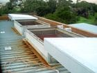 Melbourne Water - An exterior view of the open single sliding skillion style solid retractable roofs