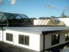 Narre Warren - An exterior view of the open bi-parting barrel vault style retractable roof