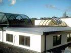 Narre Warren - An exterior view of the open bi-parting barrel vault style retractable roof