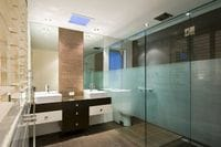 Frameless Shower Screen With Acid Etched Privacy Design. Gold Coast