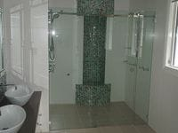 Frameless Sliding Opto Shower Screen. Saves space in the bathroom and maintains the look of luxury. Gold Coast