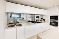 Mirrored Glass Splashback, Kirra Gold Coast. Mirror adds space and sophistication to the kitchen