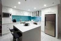 Blue Textured Glass Splashback is a winning feature in this stunning kitchen. Kingscliff