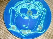 Buddha face round dinner plate in quondong and turquoise