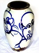 Four faces large urn in blue and white with teadust glaze inside