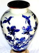 Sacred crane and lotus vase in blue and white with teadust glaze inside