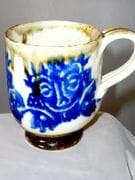 Expresso cup with barong face in blue and white with iron oxide rim