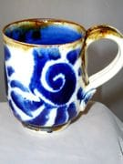 Expresso cup with nautilis shell design in blue and white and iron oxide rim