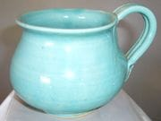 Mug in pale aqua glaze