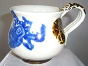 Mug with barong face in blue and white