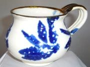 Mug with dragonfly design in blue and white with iron oxide rim
