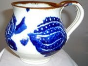 Mug with turtle design in blue and white with iron oxide rim