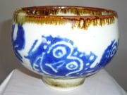 Barong face teabowl in blue and white with iron oxide rim