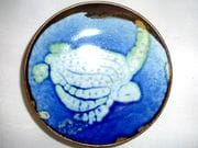 Turtle dish in blue over shino glaze