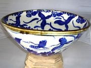 Sacred crane bowl in blue and white with iron oxide rim