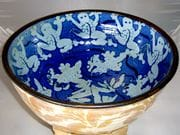 Frog bowl in blue glaze over shino and iron oxide rim