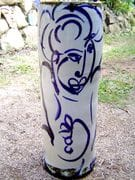 Figure tall heliconia vase in blue and white