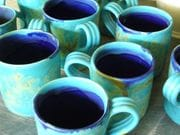 Turquoise mugs with cobalt interiors