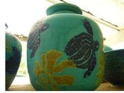 Large ginger/tea jar in turquoise with cobalt turtle design.