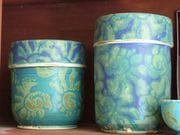 Lidded canisters in turquoise glaze.