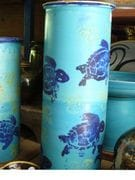 Turquoise tall jar with cobalt turtles.