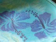Detail of turquoise/cobalt hibiscus platter.