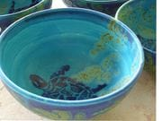 Turquoise bowl with cobalt turtle.