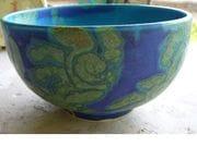 Profile of cobalt bowl with sea-sun design.