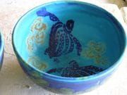 Two cobalt turtles on Turquoise glazed bowl