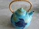 Turquoise turtle Teapot with cane handle.