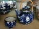 Blue and white teapot with cane handle.