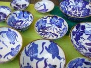 selection of blue and white bowls.
