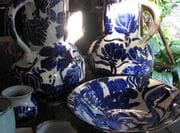 Large blue/white jugs and small bowls.