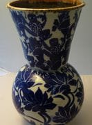 Blue and white tall vase.