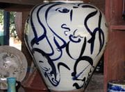 Large jar with cobalt line drawing.
