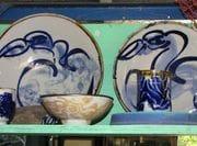 Bird line drawing in cobalt bowls.