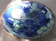 Fresh from the kiln in morning light, a 'frogs leaping' Platter in Shino, cobalt and rutile.