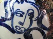 Blue design on white porcelain bowl.